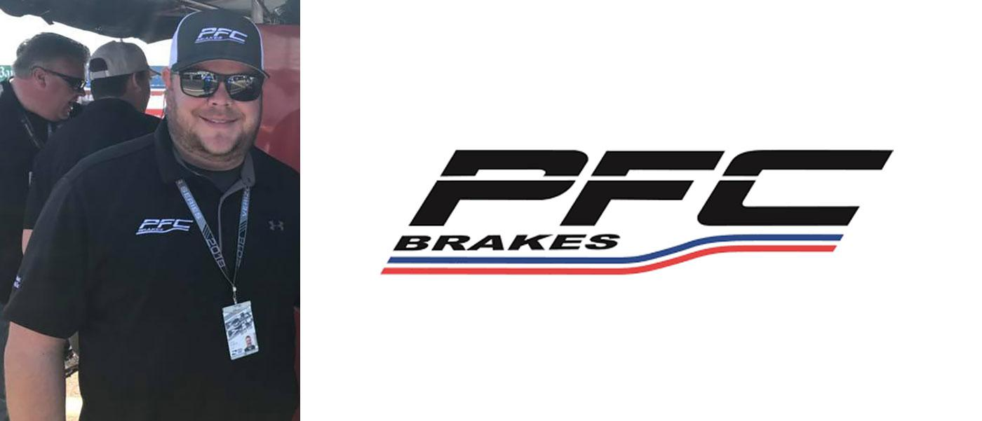 Chris Dilbeck in the pits, PFC Brakes logo