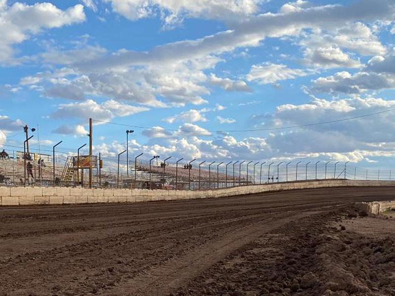 Photo of San Tan Ford's Arizona Speedway dirt track and grandstands with a blue sky