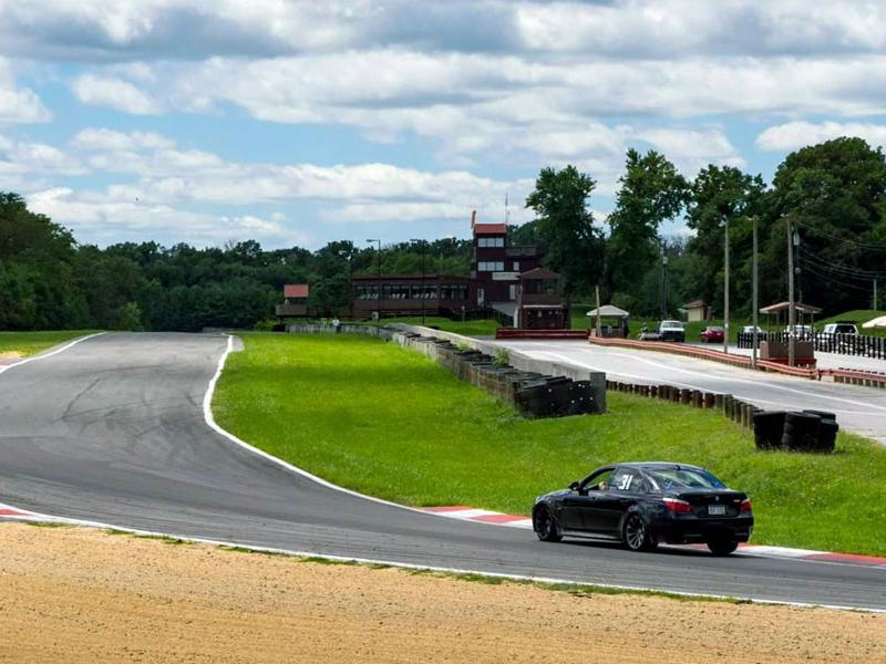 Race car rounding a corner at Summit Point Motorsports Park in West Virginia. Photo courtesy of Summit Point Motorsports Park, Facebook