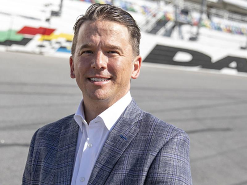New Daytona International Speedway President Frank Kelleher standing on the race track. Photo courtesy of DIS